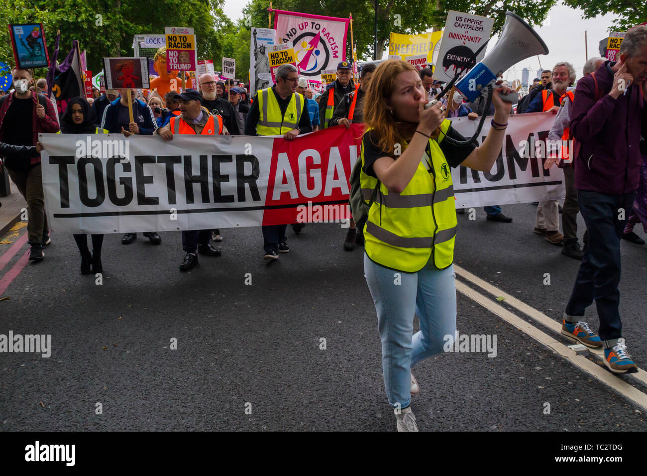 London, UK. People march from the rally in Whitehall to Parliament Square for a further rally to send a clear message that President Trump is not welcome here because of his climate denial, racism, Islamophobia, misogyny and bigotry. His policies of hate and division have energised the far right around the world. 4th June, 2019. Peter Marshall IMAGESLIVE Credit: Peter Marshall/IMAGESLIVE/ZUMA Wire/Alamy Live News Stock Photo