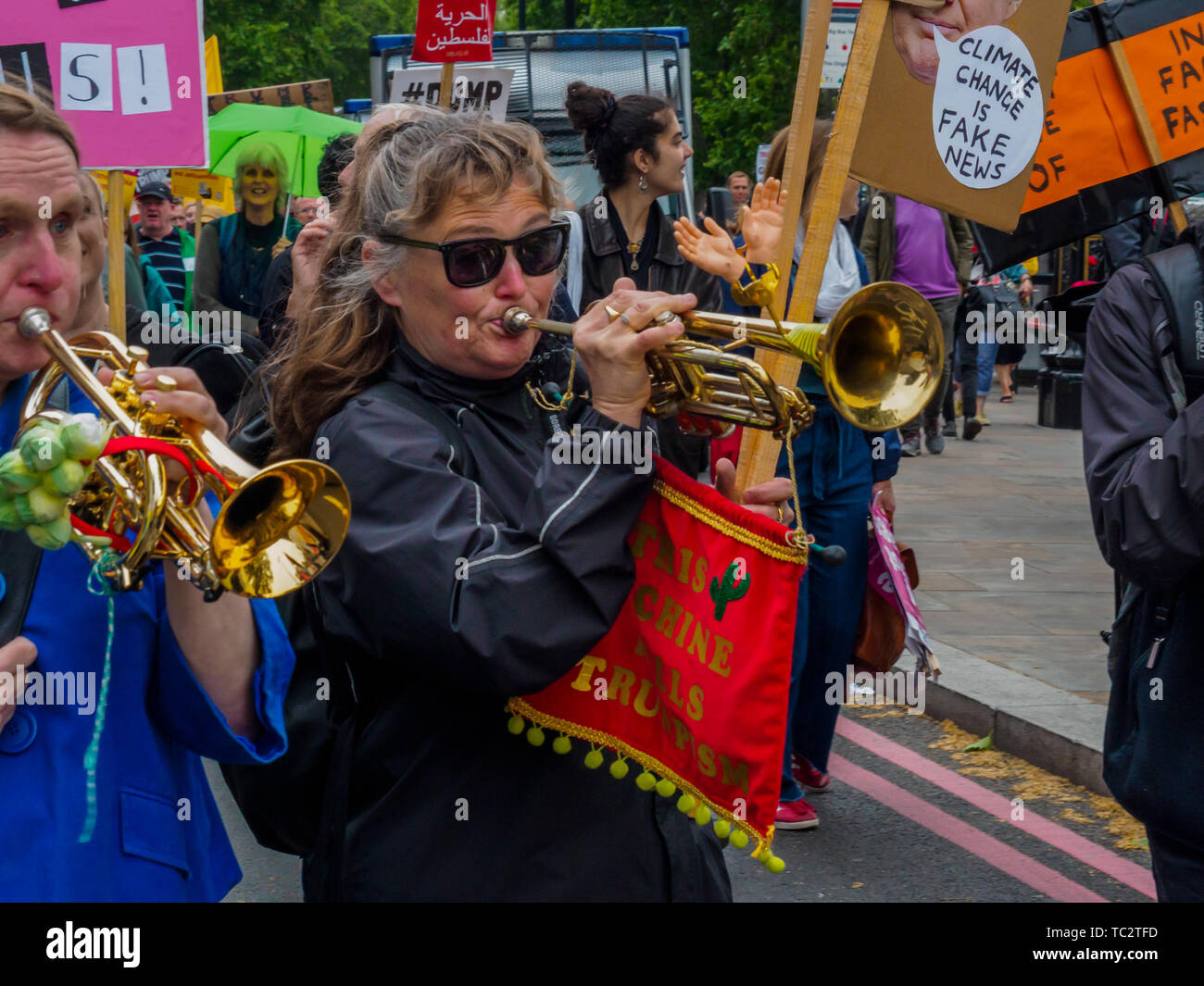 London, UK. Trumpeters on the march from the rally in Whitehall to Parliament Square for a further rally to send a clear message that President Trump is not welcome here because of his climate denial, racism, Islamophobia, misogyny and bigotry. His policies of hate and division have energised the far right around the world. 4th June, 2019. Peter Marshall IMAGESLIVE Credit: Peter Marshall/IMAGESLIVE/ZUMA Wire/Alamy Live News Stock Photo