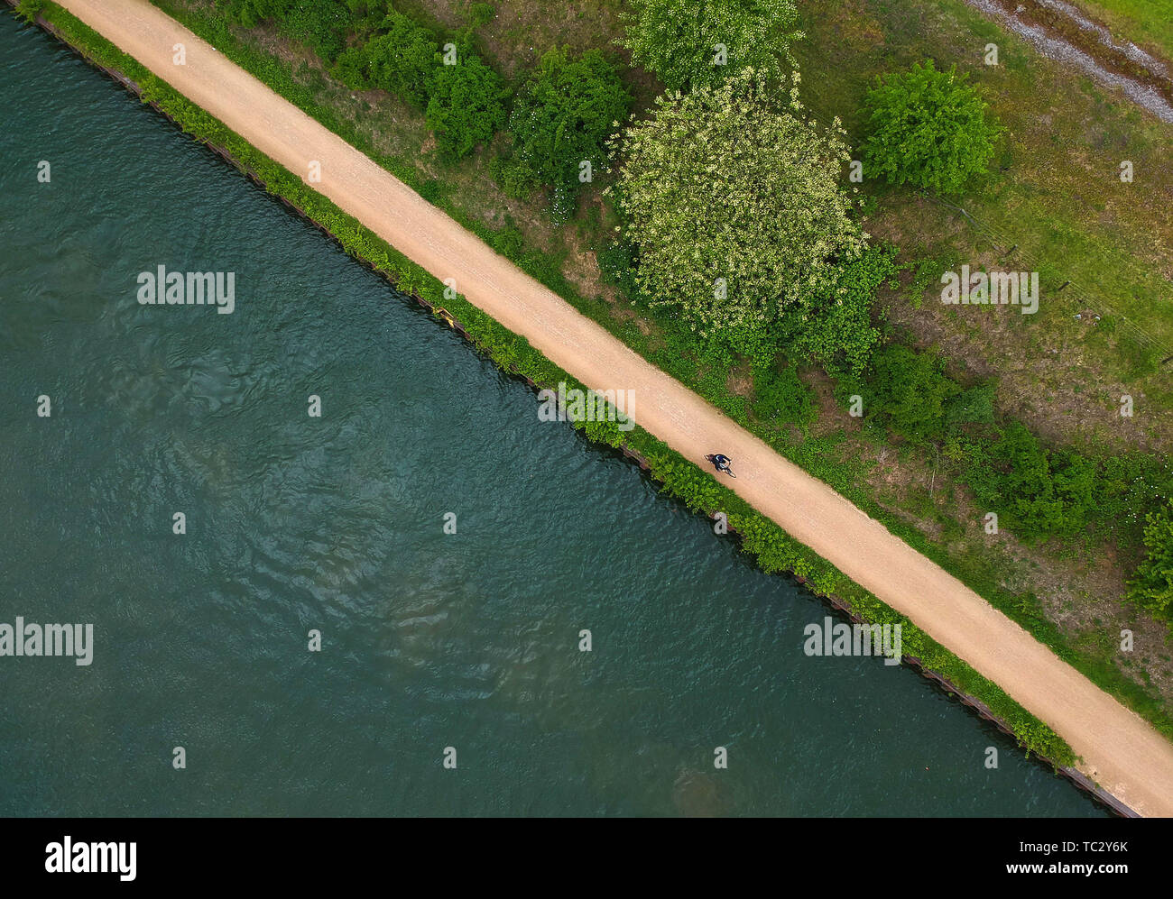 Beijing, China. 10th May, 2019. Aerial photo taken on May 10, 2019 shows a citizen riding beside the Emscher River in Essen, Germany. Credit: Lu Yang/Xinhua/Alamy Live News Stock Photo