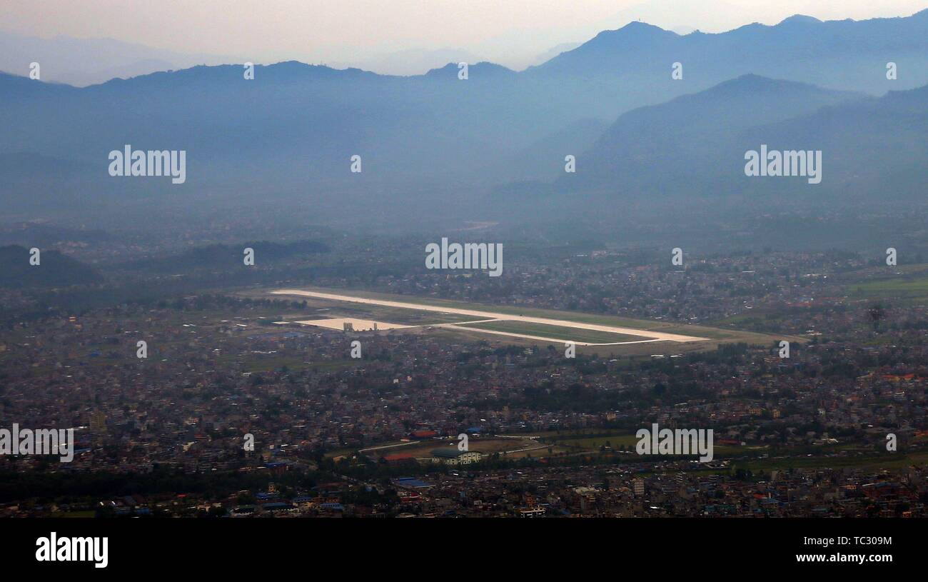 Pokhara. 4th June, 2019. Aerial photo taken on June 4, 2019 shows the newly constructed runway of Pokhara Regional International Airport in Pokhara, Nepal. The runway of Pokhara International Airport is 2,500 meters in length and 45 meters in width, which can handle medium category jets such as Boeing 757 and Airbus 320, according to Civil Aviation Authority of Nepal (CAAN). Credit: Sunil Sharma/Xinhua/Alamy Live News - Stock Image