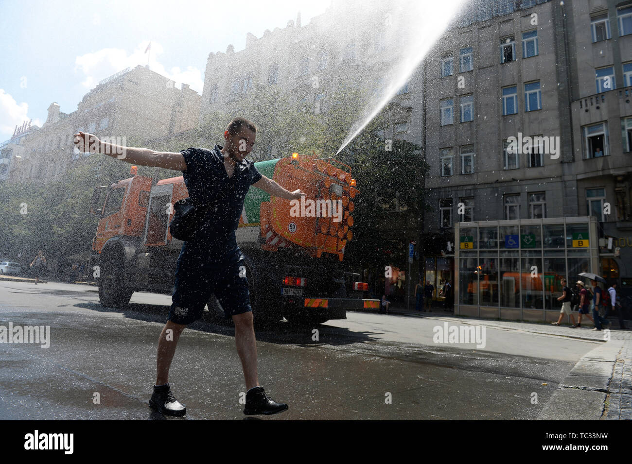 Prague, Czech Republic. 05th June, 2019. A tank truck of the 'Technical Road Administration Prague' (TSK) sprinkles by water the Wenceslas Square in Prague, Czech Republic, on June 5, 2019. Trucks go out whenever three days in a row the temperature exceeds 25 degrees Celsius. Credit: Katerina Sulova/CTK Photo/Alamy Live News - Stock Image