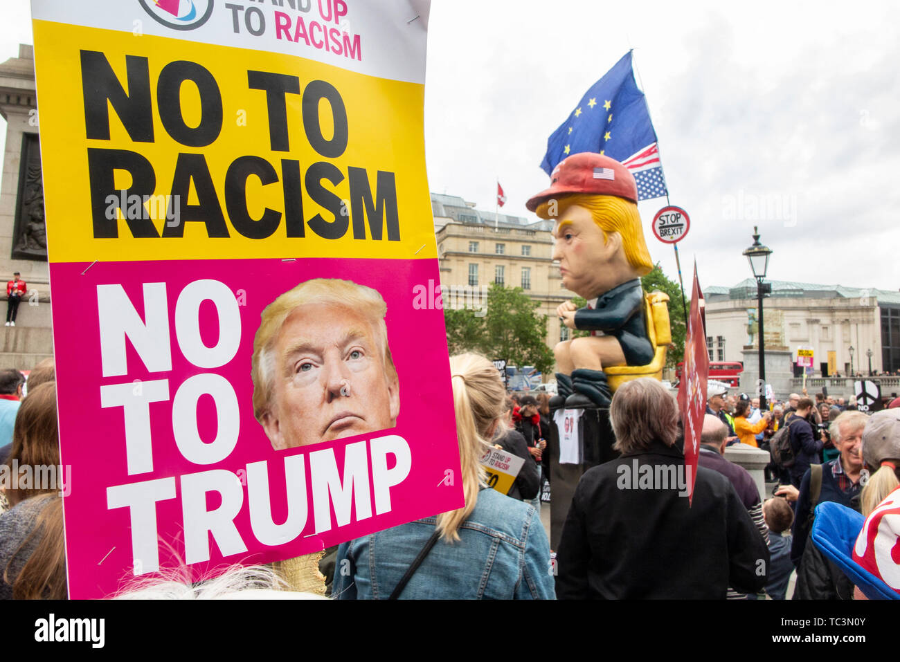 Anti Racism posters at Trafalgar Square during demonstrations against the state visit of Donald Trump - Stock Image