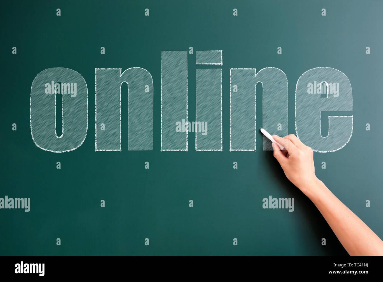 online written on blackboard - Stock Image
