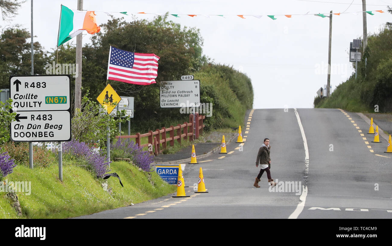 Flags in the village of Creagh in Co Clare as a huge security operation swings into operation ahead of the arrival of US President Donald Trump. - Stock Image