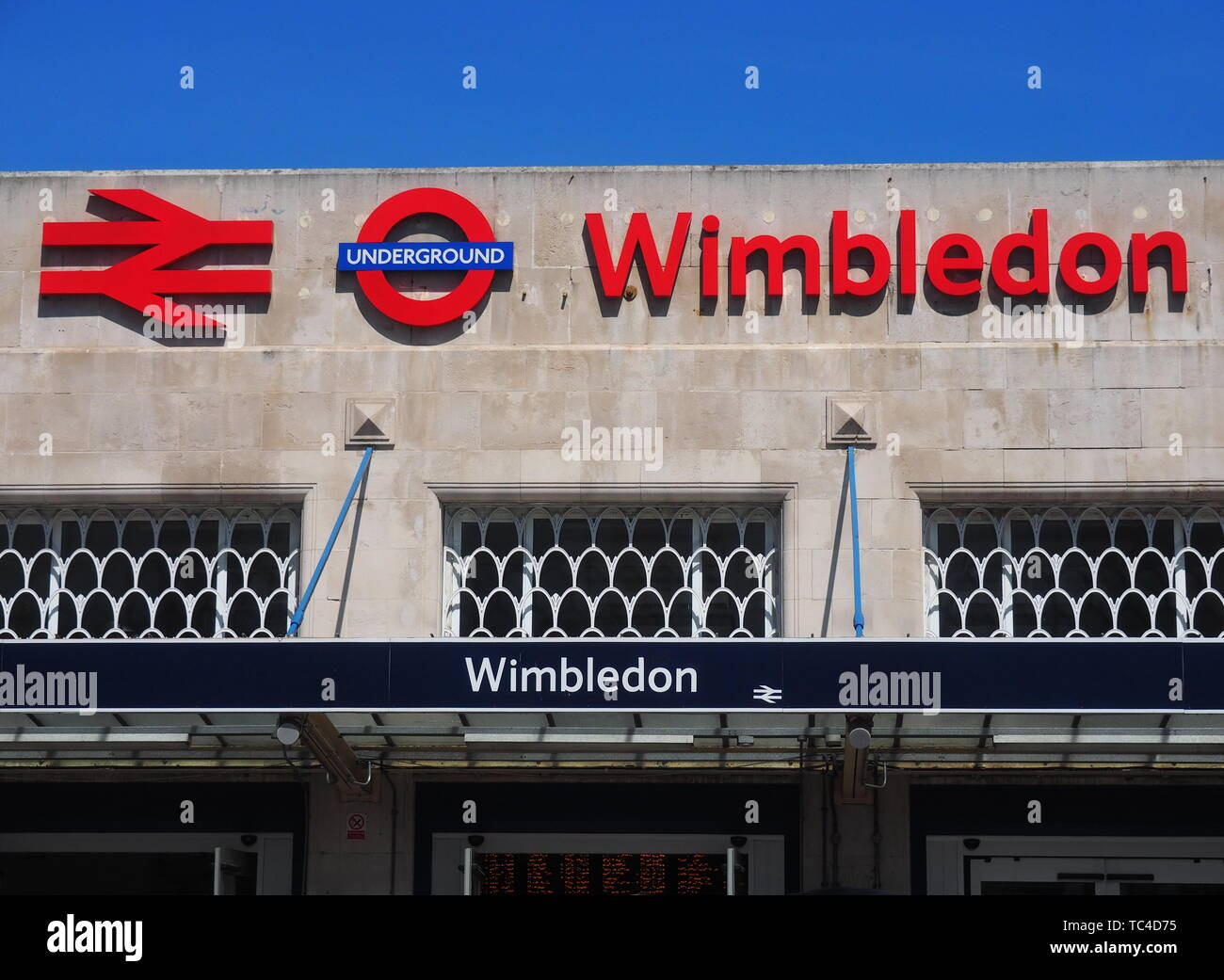 Wimbledon, London: 14 may 2019: Wimbledon railway and underground station exterior in south west London - Stock Image