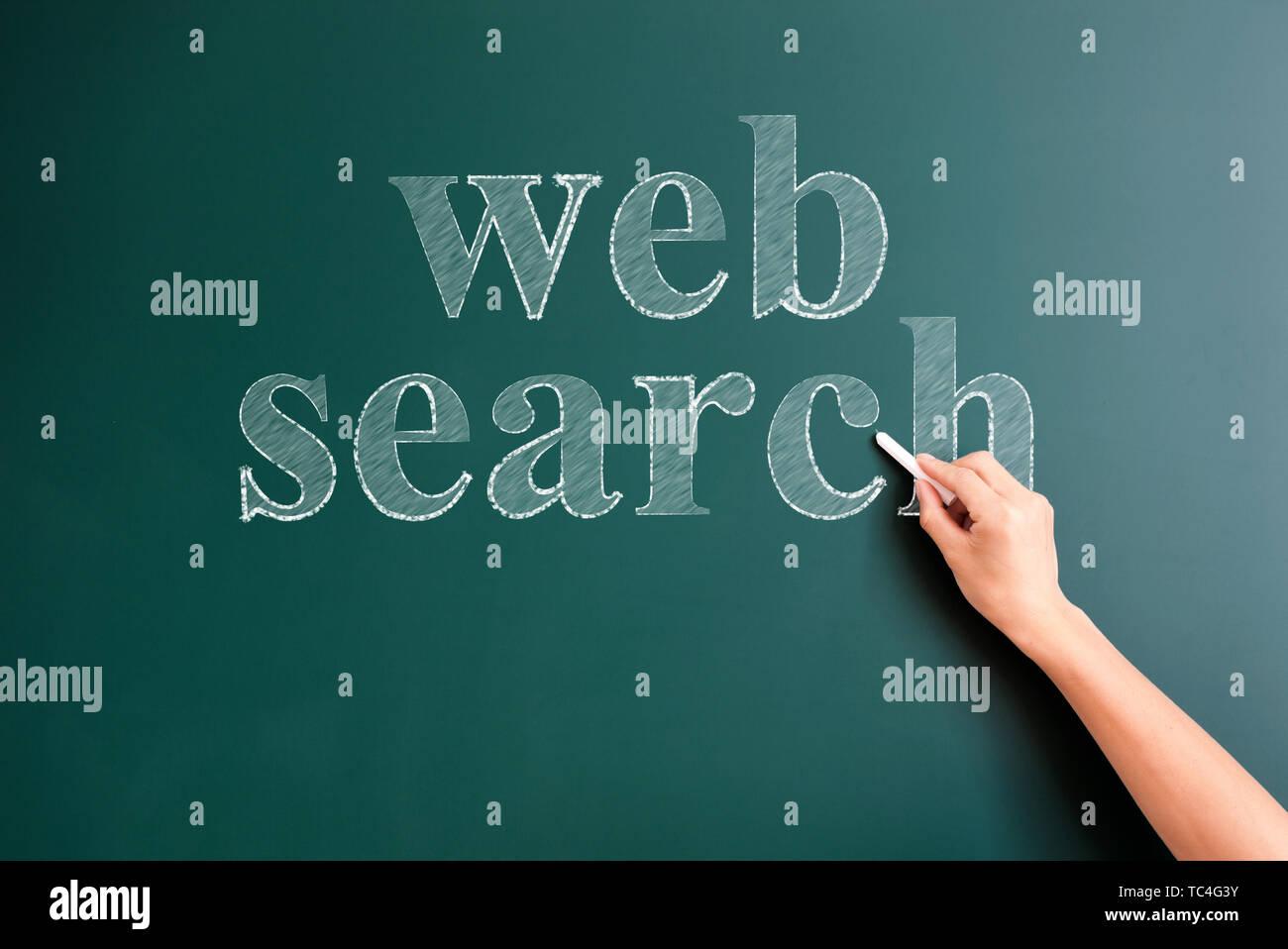 web search written on blackboard - Stock Image