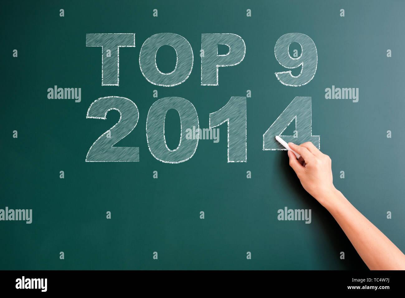 top 9 2014 written on blackboard - Stock Image