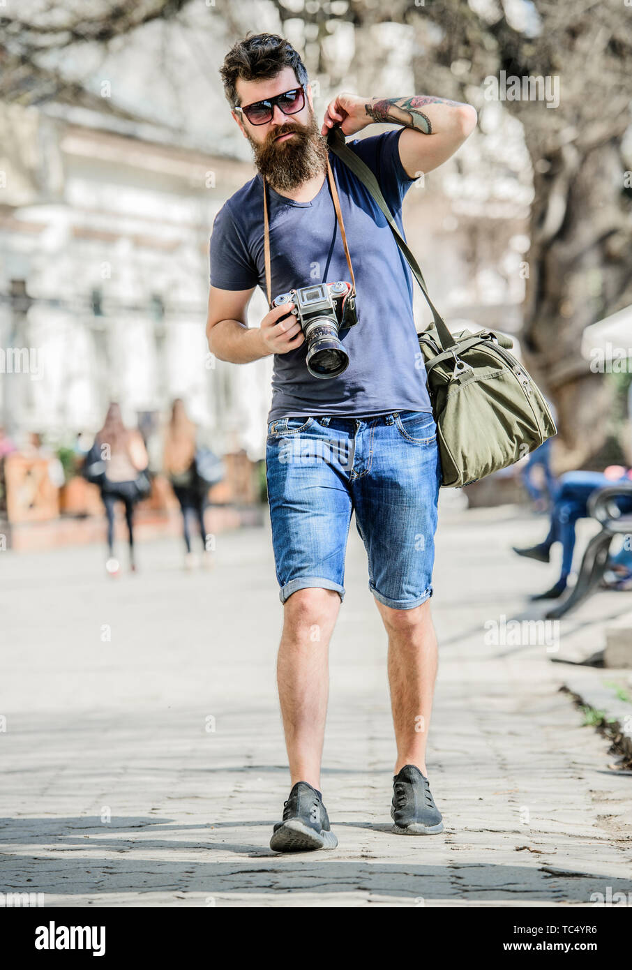 Manual settings. Photographer with beard and mustache. Tourist shooting photos. Content creator. Man bearded hipster photographer. Old but still good. Photographer hold vintage camera. Modern blogger. - Stock Image