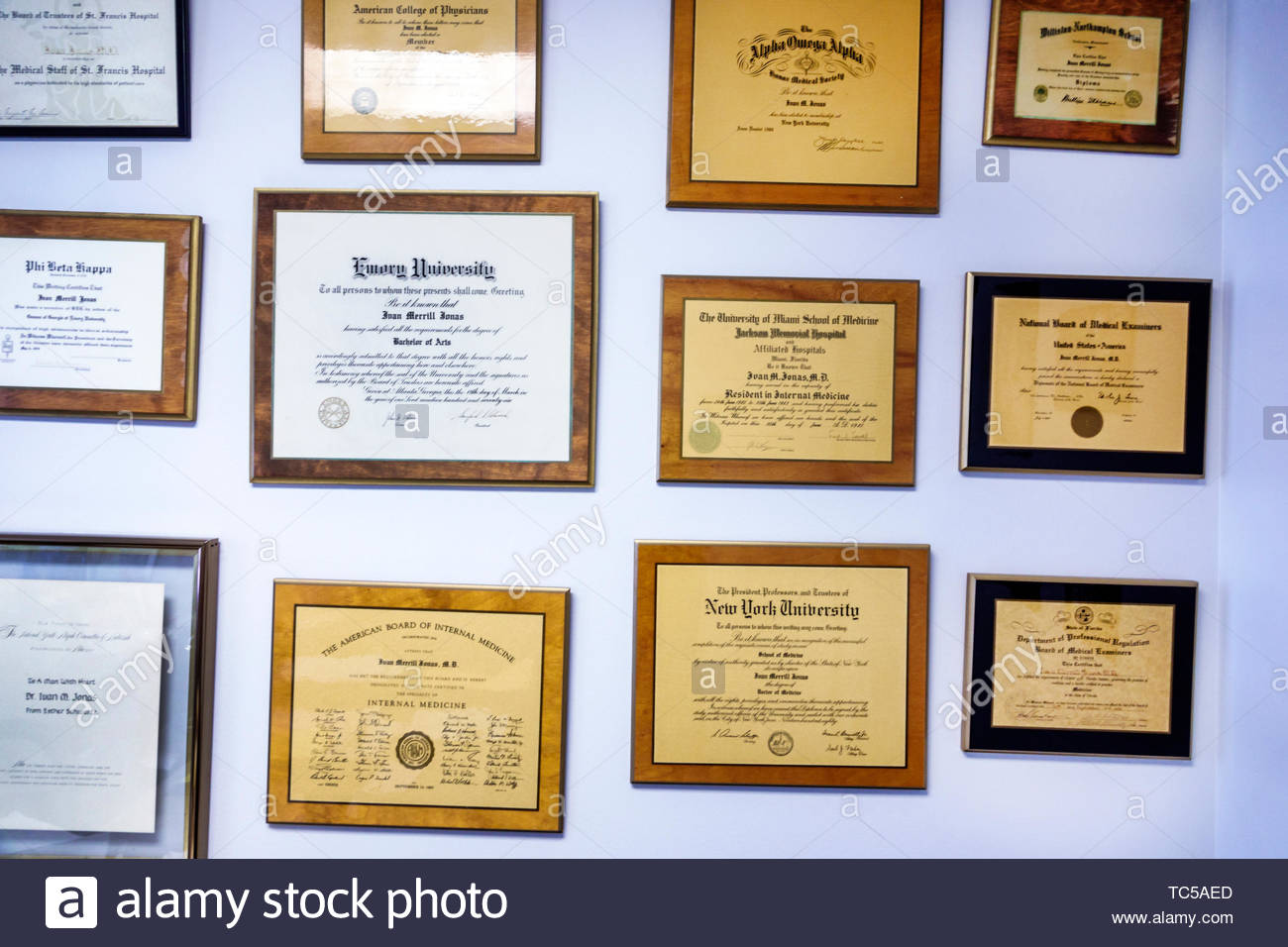 Miami Beach Florida doctor's physician's office diplomas plaques hanging wall - Stock Image