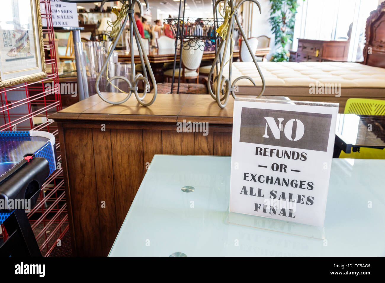 Miami Florida Salvation Army Family Store used clothing furniture household items for sale donated donations low income shopping sign no refunds excha - Stock Image