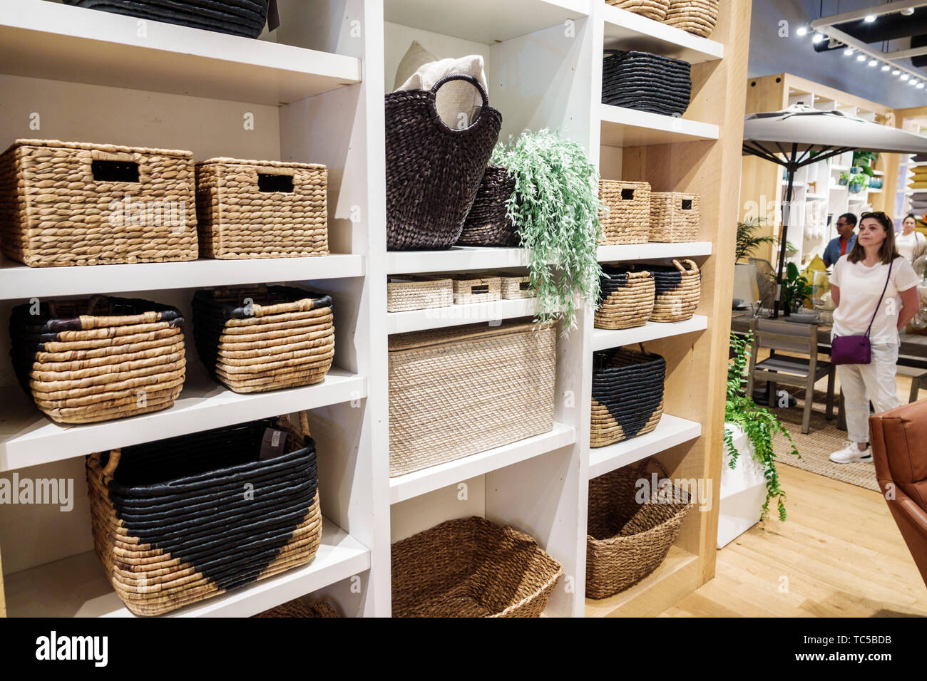 Miami Florida Midtown The Shops at Midtown Miami shopping West Elm home retailer store business inside display sale baskets home decor Stock Photo