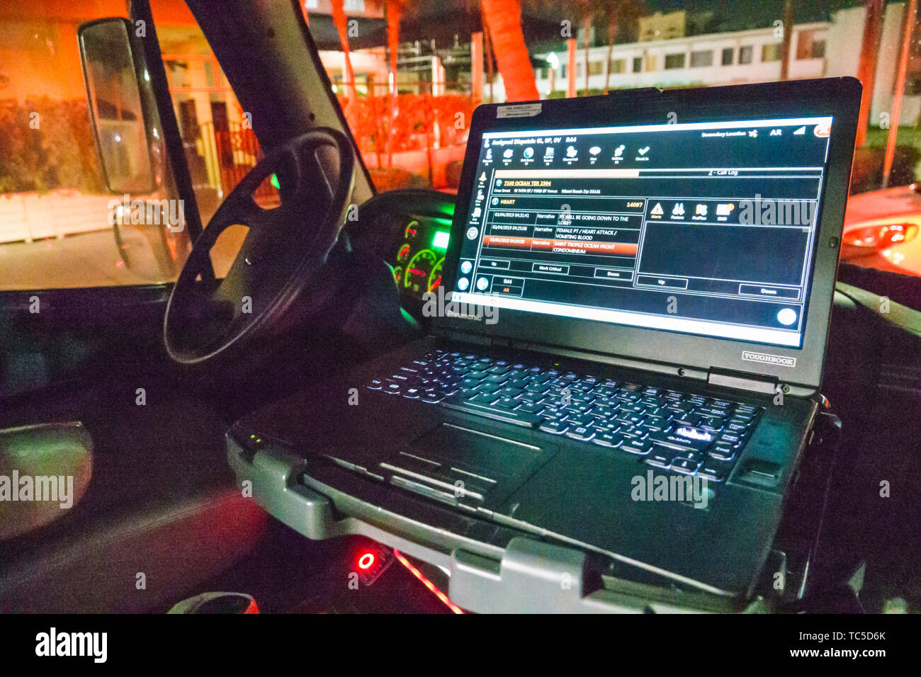 Miami Beach Florida North Beach Fire Rescue ambulance inside laptop computer screen medical emergency event possible heart attack details night - Stock Image