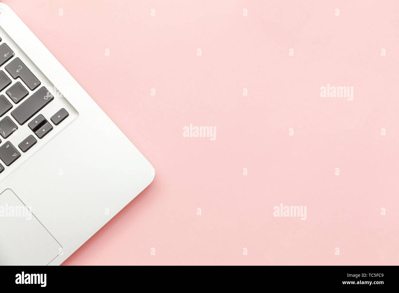 Keyboard Laptop Computer Isolated On Pink Pastel Desk Background