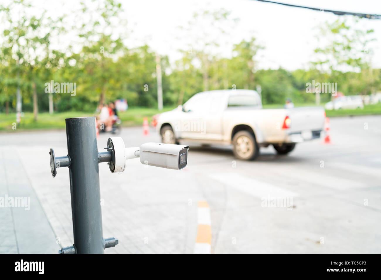 surveillance camera at entrance department store - Stock Image