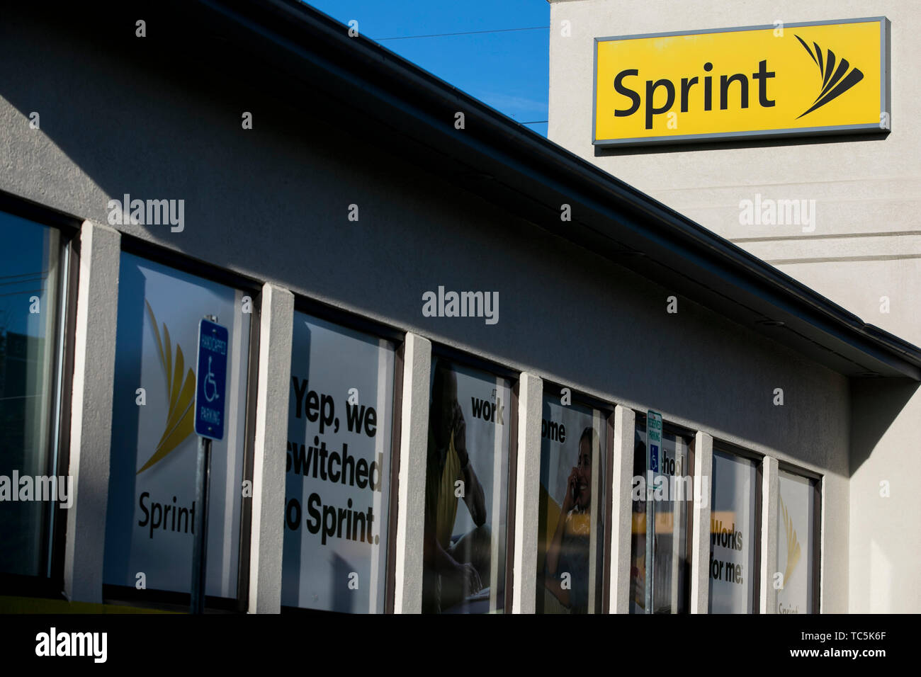 A logo sign outside of a Sprint Corporation retail store location in Martinsburg, West Virginia on June 4, 2019. - Stock Image
