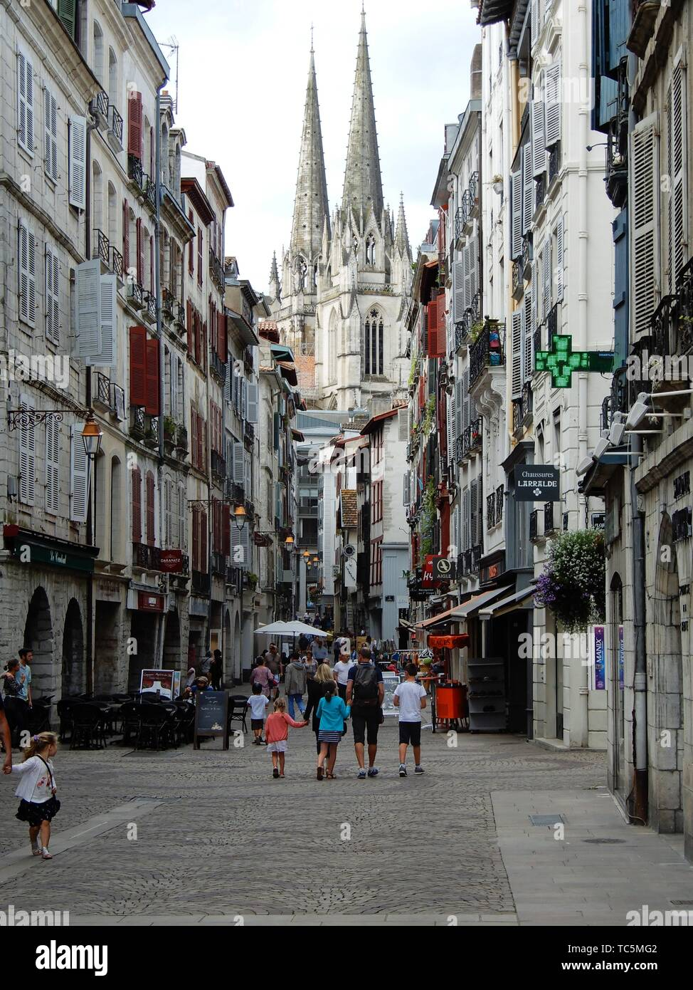 Street Scene with Cathedral of Notre-Dame de Sainte-Marie, Bayonne, France. Stock Photo