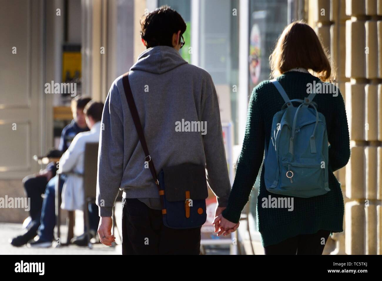 young couple walking hand in hand, street life, old town of Bayreuth, Maximilianstrasse - main touristic promenade in old town, Bayreuth, capital of Stock Photo