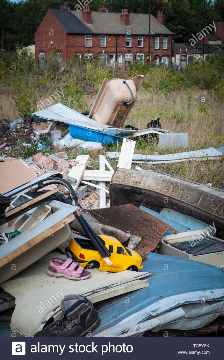 Fly-tipped refuse near houses, West Midlands, UK - Stock Image