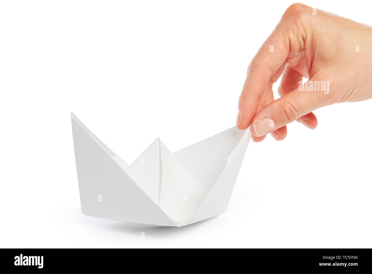 Paper ship in a female hand - Stock Image