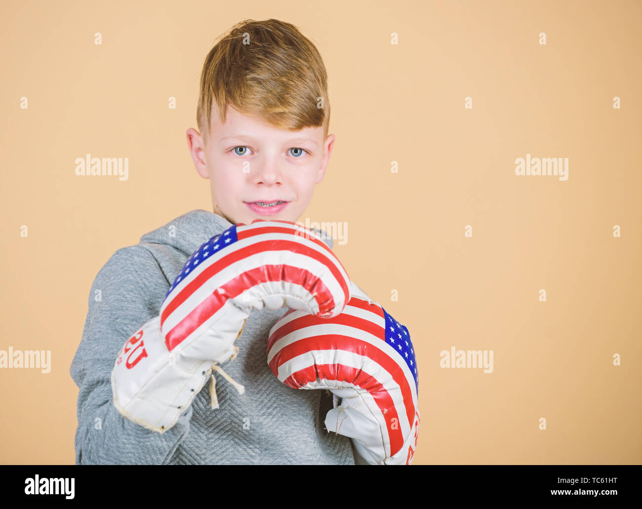 no pain no gain. Fitness diet. energy health. Sport success. sportswear. workout of small boy boxer. usa independence day. child sportsman in boxing gloves. punching knockout. Childhood activity. - Stock Image