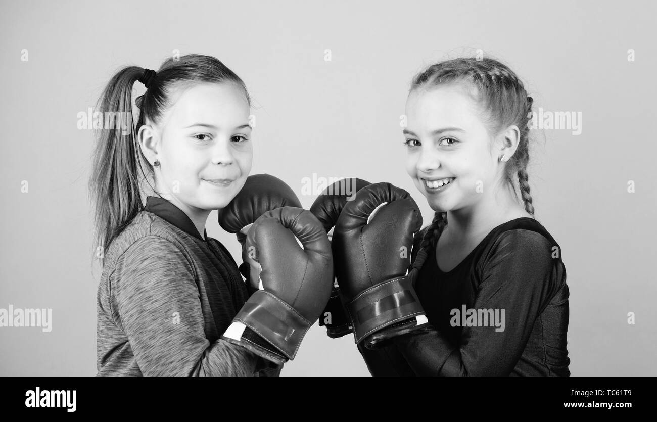 Fitness diet. energy health. Sport success. Friendship. workout of small girls boxer in sportswear. Happy children sportsman in boxing gloves. punching knockout. Childhood activity. Caucasian boxer. - Stock Image