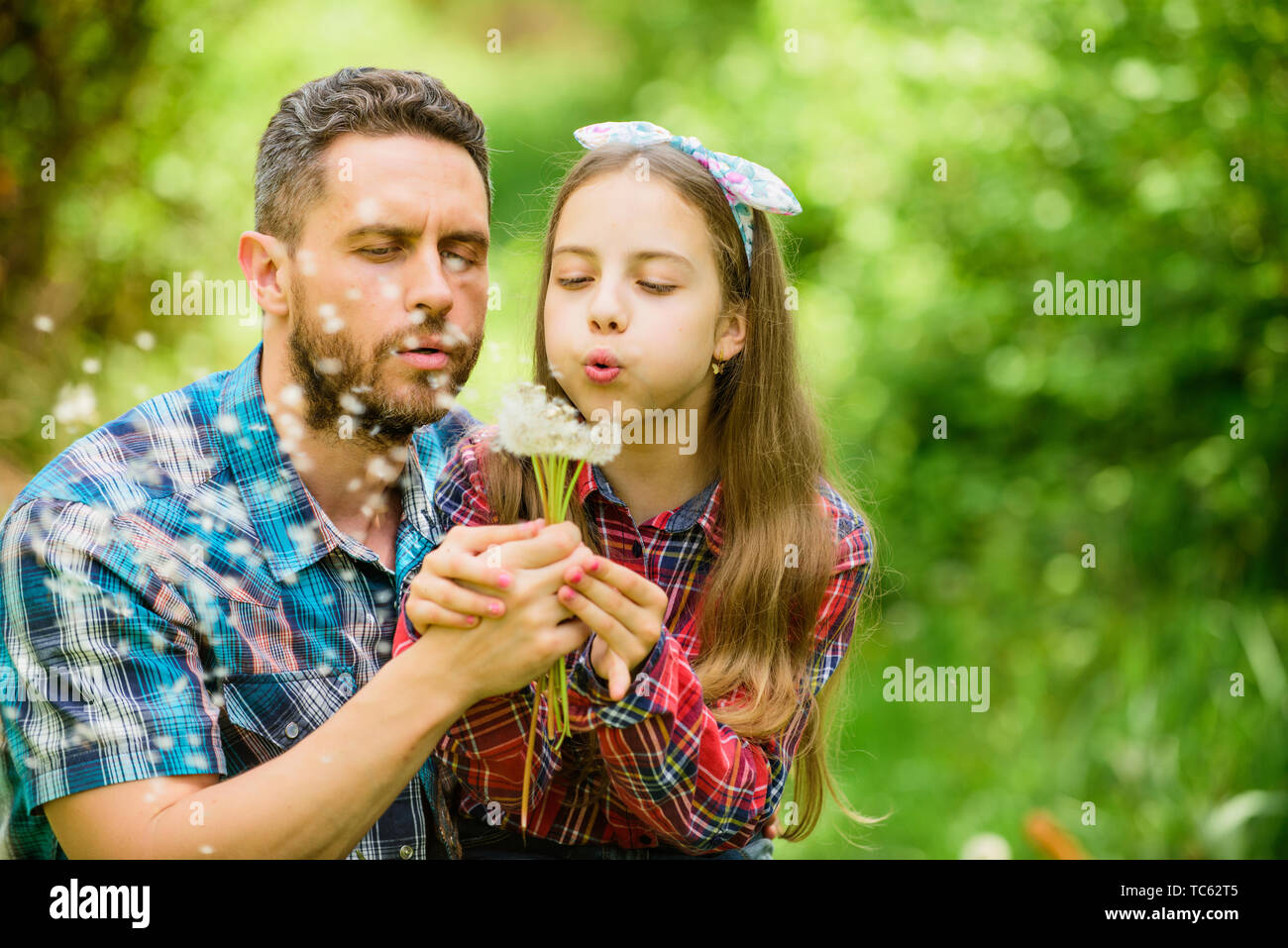 daughter and father love dandelion flower. family summer farm. spring village country. little girl and happy man dad. earth day. ecology. Happy family day. Tender moment. - Stock Image