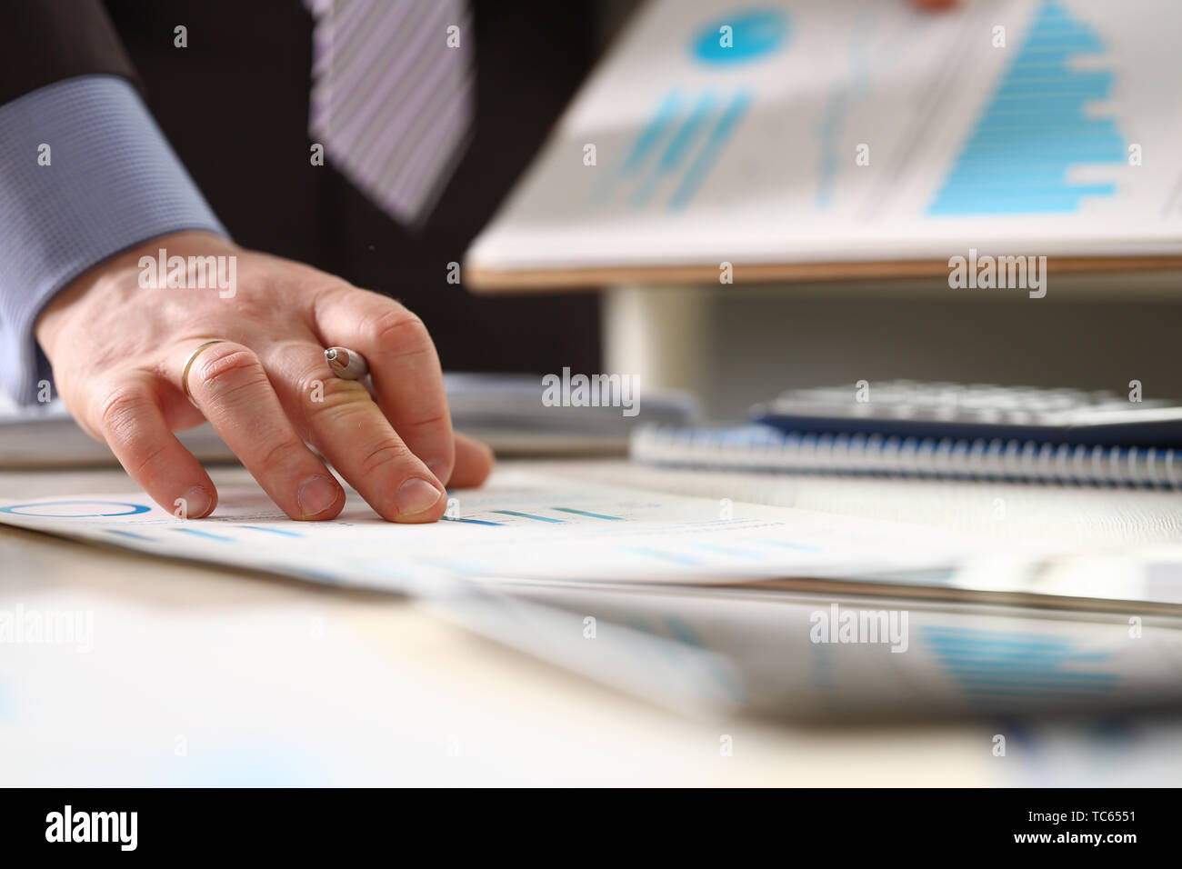 Person Controlling Prices Rise Accounting Income - Stock Image