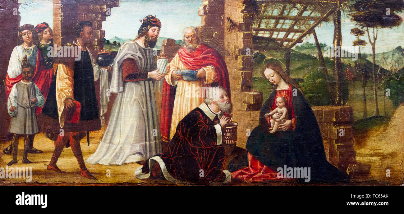 Adoration of the Magi who lay before Infant Jesus gifts of gold, frankincense, and myrrh, and worship Him. XVI century. Castello Visconteo. - Stock Image