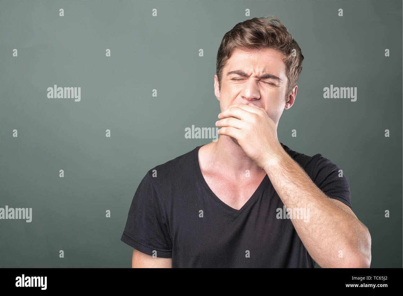 Portrait of yawning man - Stock Image