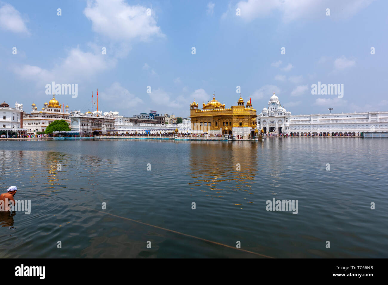 Sikh pilgrim. Some Sikh take a dip in the pool. The Harmandar Sahib , Golden Temple,  Amritsar, Punjab, India Stock Photo