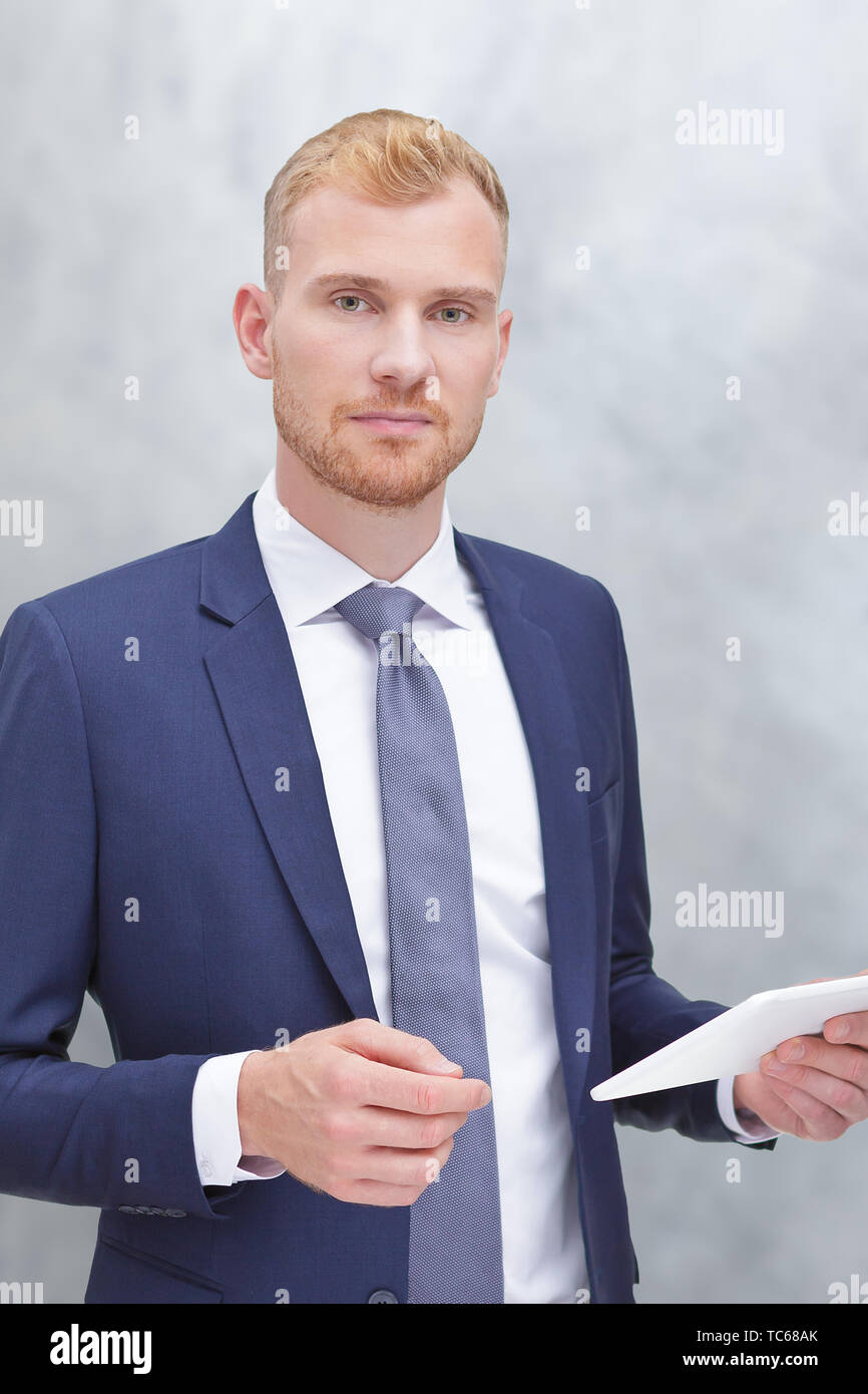 Modern portrait of an adult man with tablet computer, insurance agent, bank advisor or tax consultant. - Stock Image
