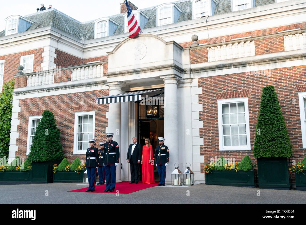 London, UK. 04th June, 2019. U.S President Donald Trump and First Lady Melania Trump wait to greet Prince Charles and the Duchess of Cornwall prior to a gala at Winfield House June 4, 2019 in London, England. Credit: Planetpix/Alamy Live News - Stock Image