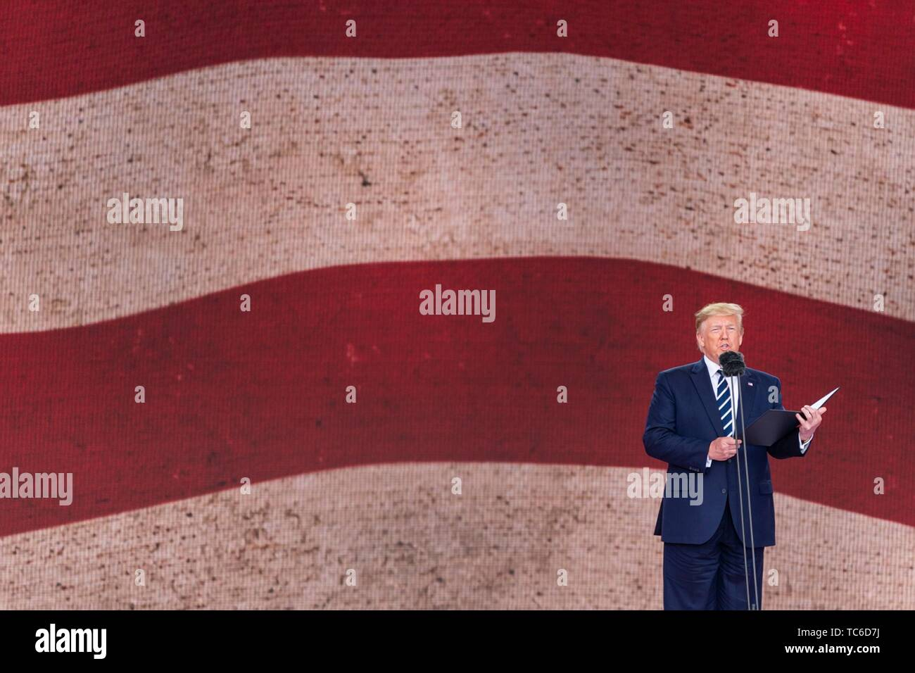 Portsmouth, UK. 05th June, 2019. U.S President Donald Trump addresses an event to marking the 75th anniversary of D-Day June 5, 2019 in Portsmouth, England. World leaders gathered on the south coast of England where troops departed for the D-Day assault 75-years-ago. Credit: Planetpix/Alamy Live News - Stock Image