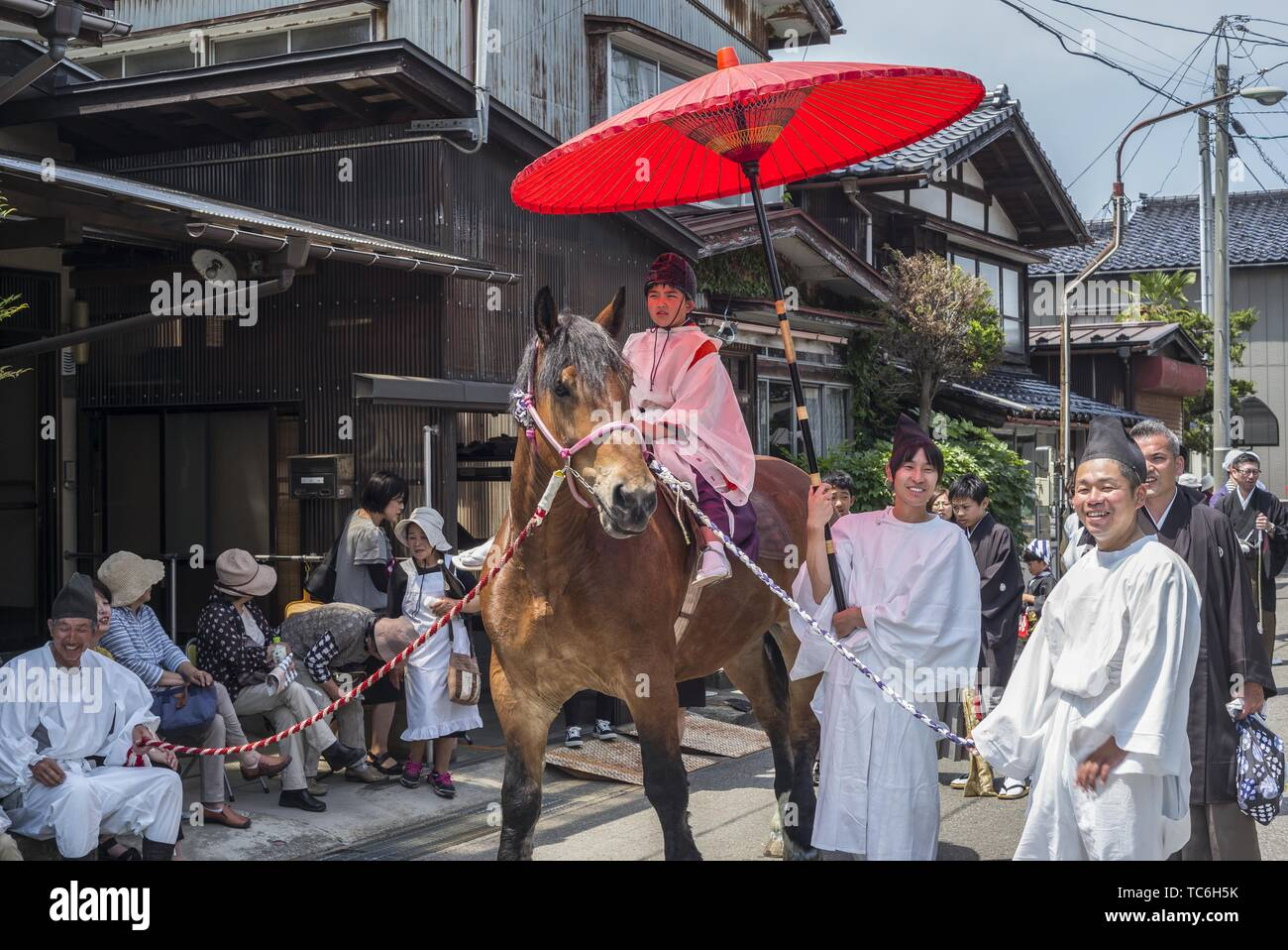 Oyama, Japan. 05th June, 2019. Oyama Inu Matsuri (Dog Festival) June 5th. The festival is based on a 300 year old legend that takes place in the 1500 year old Sugio Jinja Shrine in Oyama. Legend has it that the shrine was tormented by demons who demanded the sacrifice of a young girl every year. The villagers complied to avoid famine and torment. A simple dog named Mekke Inu finally killed all the demons, but in the process became mortally wounded and died. The festival commemorates the heroic dog with a parade around the town ending at the shrine. Credit: ZUMA Press, Inc./Alamy Live News - Stock Image
