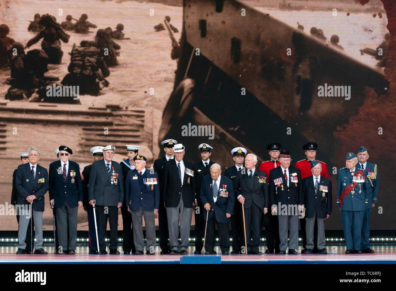Portsmouth, UK. 05th June, 2019. World War Two veterans stand onstage during an event to marking the 75th anniversary of D-Day at the Southsea Common June 5, 2019 in Portsmouth, England. World leaders gathered on the south coast of England where troops departed for the D-Day assault 75-years-ago. Credit: Planetpix/Alamy Live News Stock Photo