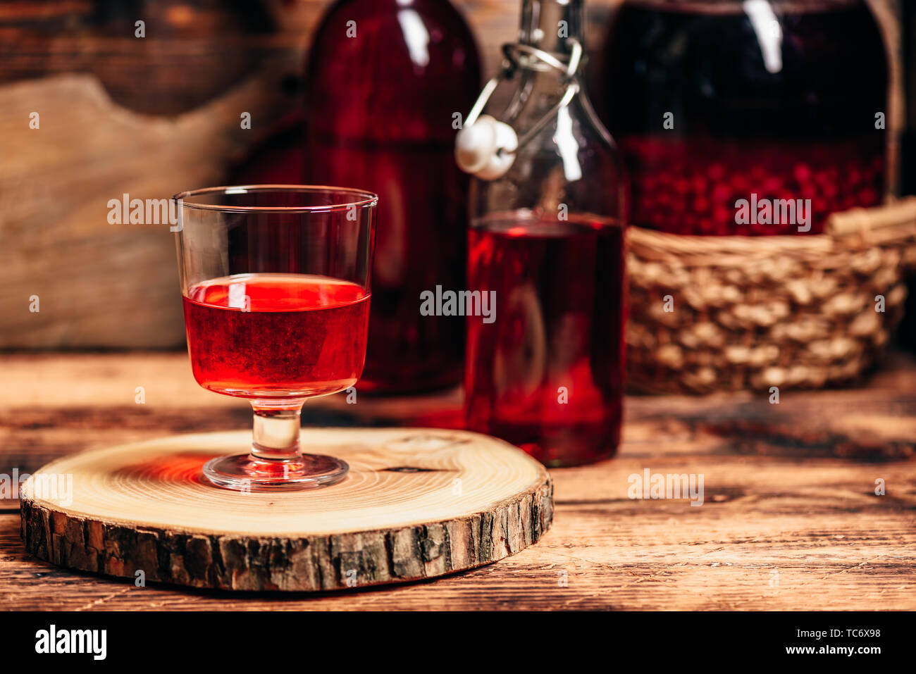 Homemade red currant liquor in wine glass - Stock Image