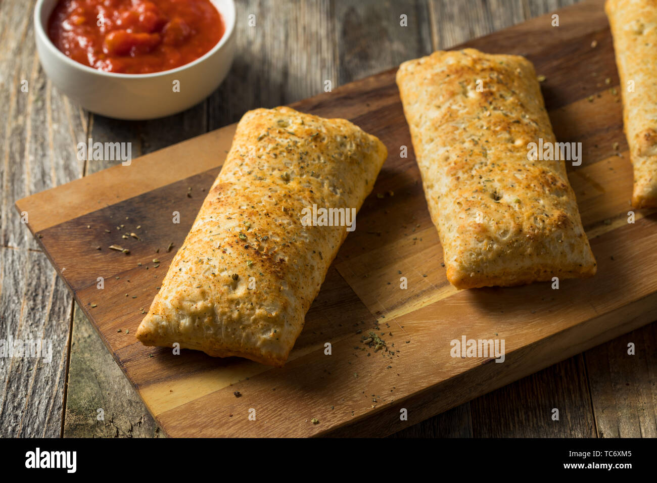Unhealthy Microwaved Pizza Pockets with Cheese and Sauce - Stock Image