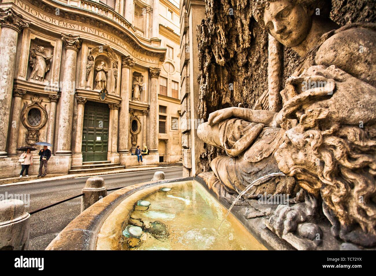 On background the church of San Carlo alle Quattro Fontane, Saint Charles at the Four Fountains, San Carlino, Baroque architecture, at right the - Stock Image