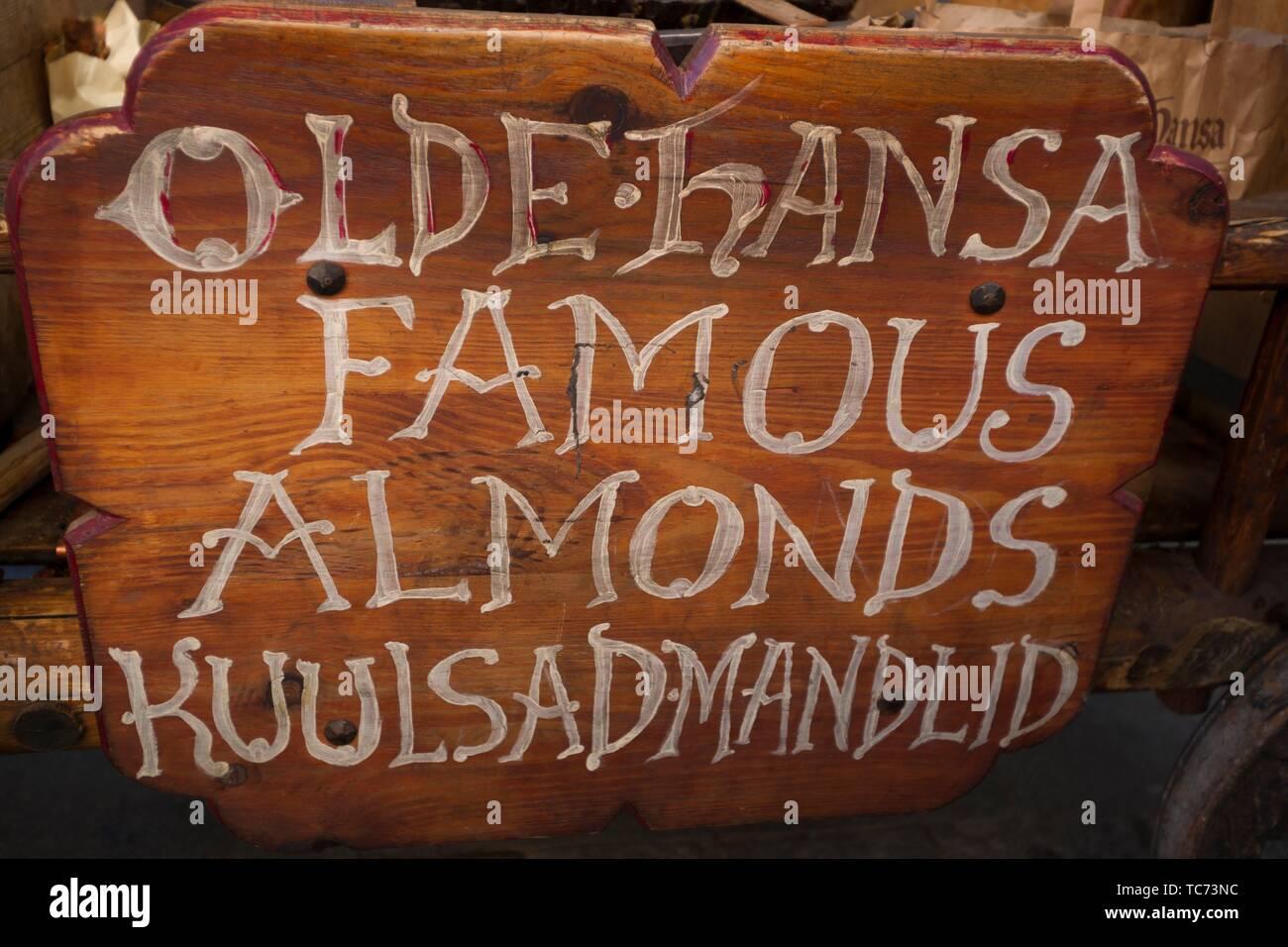Sign for Olde Hansa sweet almonds. Tallinn Town Hall Square (Raekoja Plats). Old Town, Tallinn, Estonia, Baltic States. - Stock Image