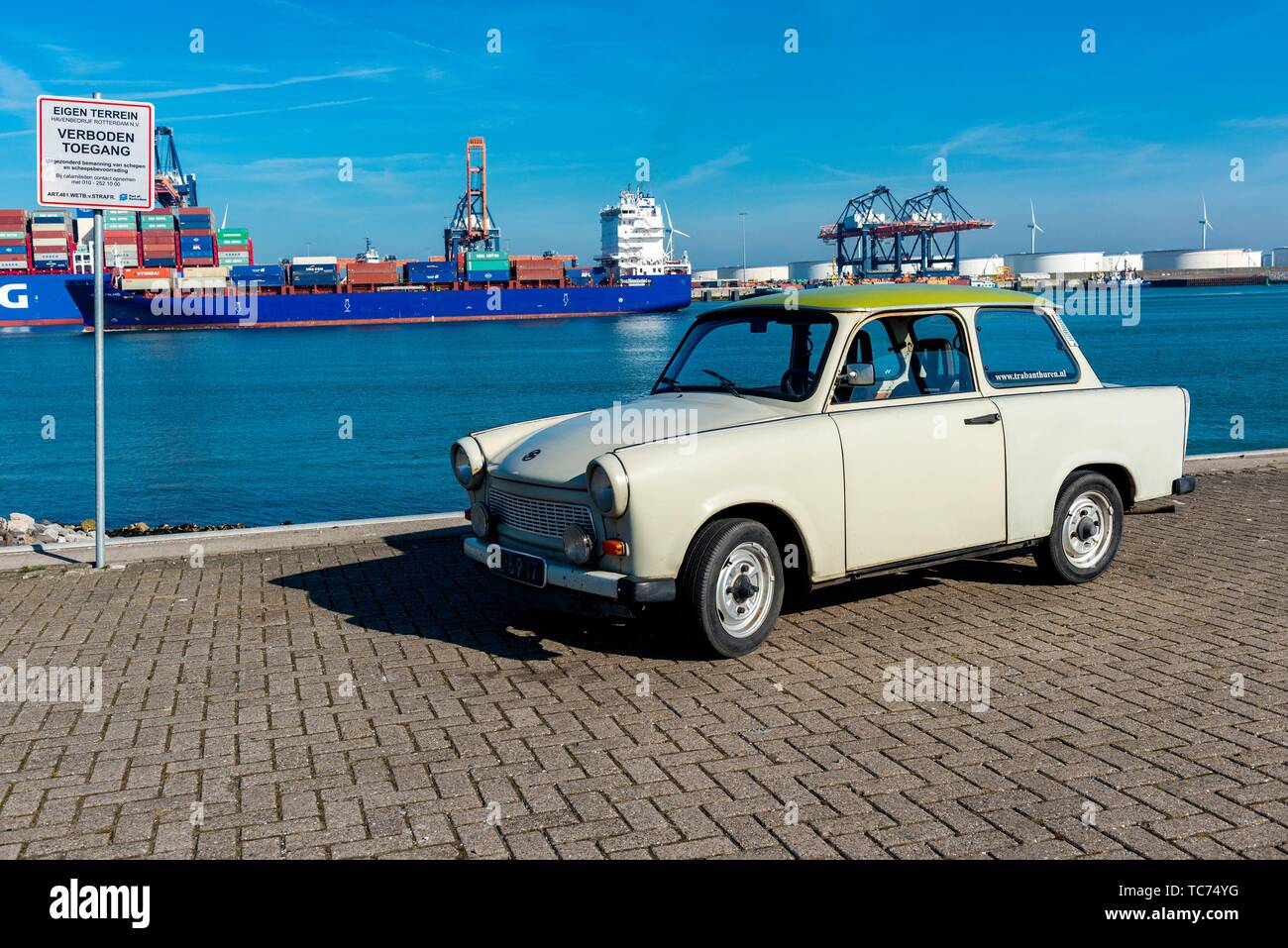 Rotterdam, Netherlands. A Deutsche Democratische Republik build, vintage Trabant (1971) driving around the Port of Rotterdam Harbor area on a sunny, Stock Photo