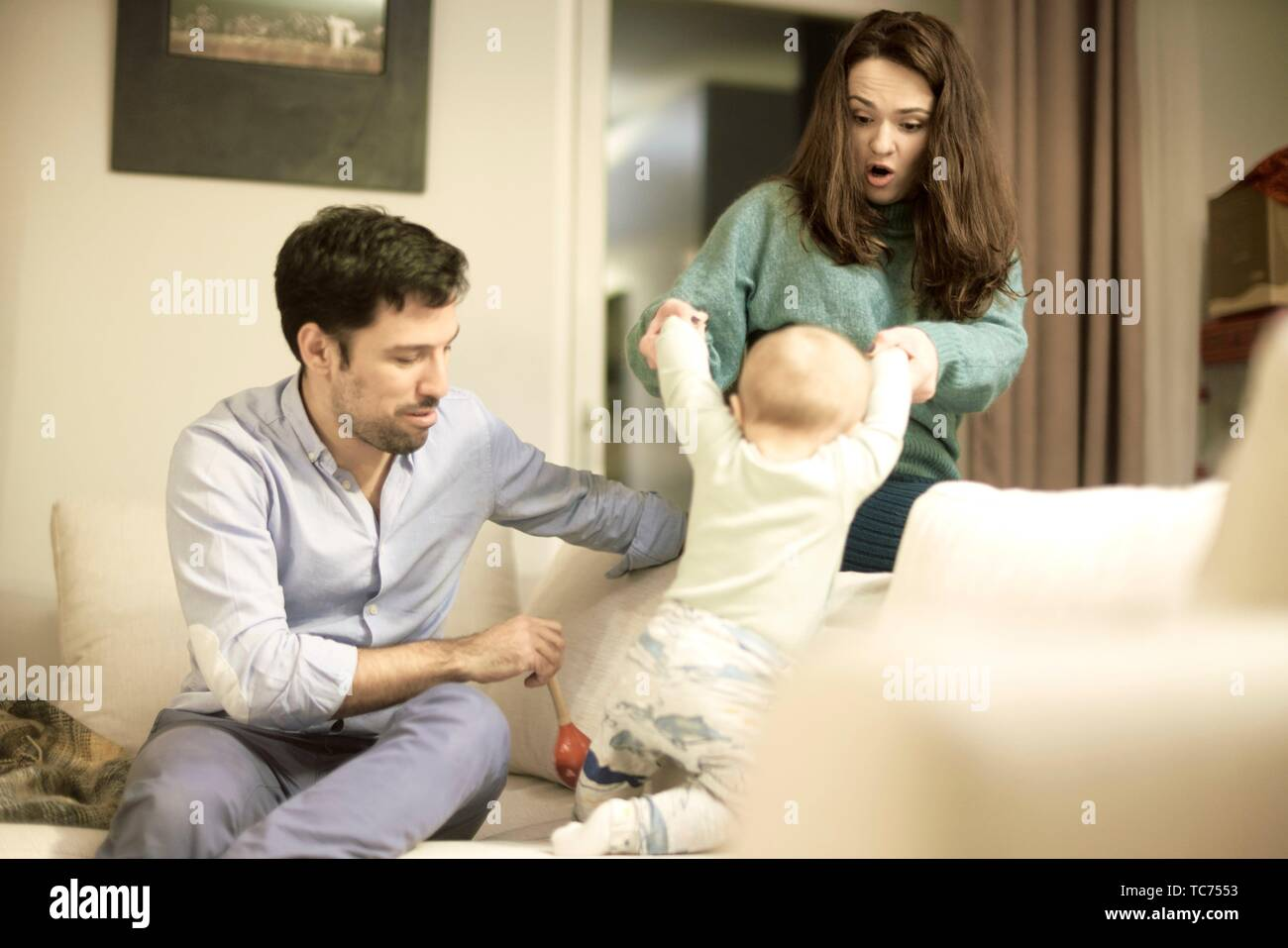 couple with baby at home, in Munich, Germany Stock Photo
