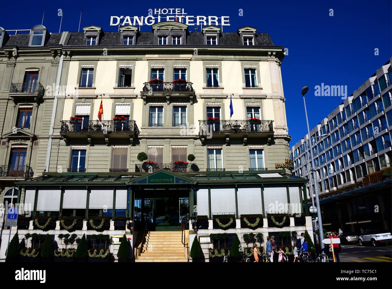 Quai du Mont -Blanc along Lake Geneva, Five-star luxury historic hotel Hôtel d'Angleterre, Geneva, Switzerland, Europe - Stock Image