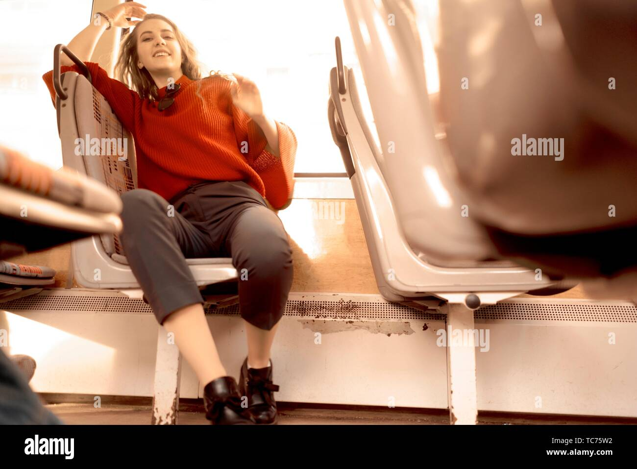 young woman sitting in public transport, in city Cottbus, Brandenburg, Germany. Stock Photo