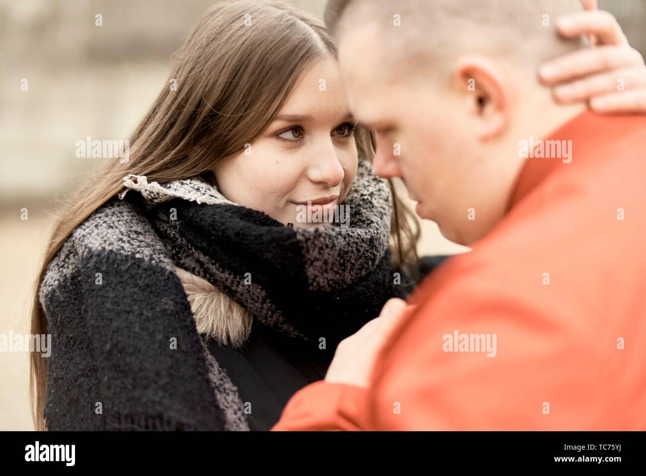 couple looking at each other, outdoors in Cottbus, Brandenburg, Germany - Stock Image