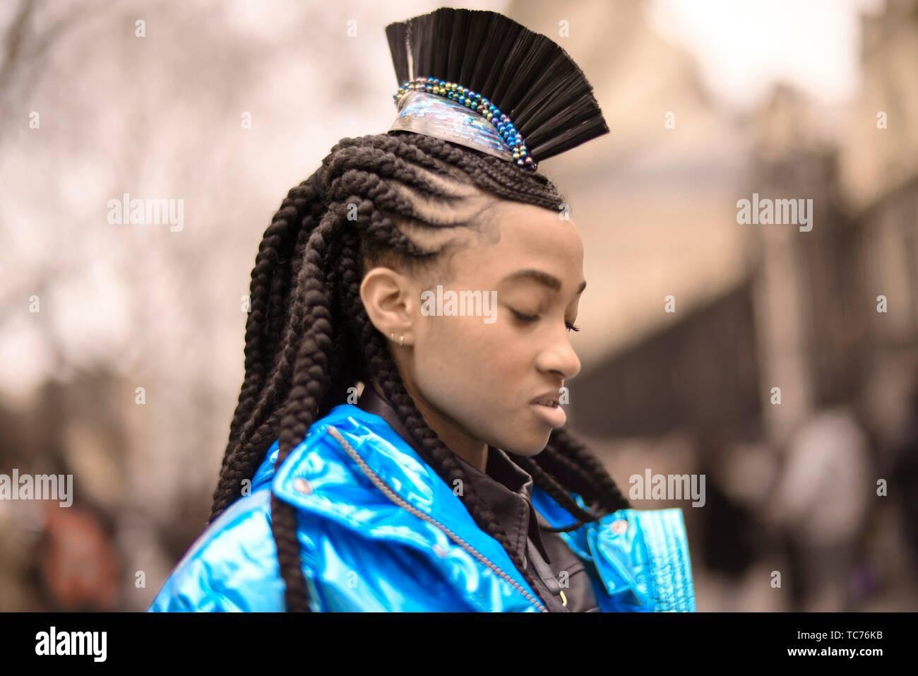 Street Style - Paris Fashion Week Womenswear Fall/Winter 2019/2020, guest with hair decoration, dreadlock hair style, seen outside Altuzarra, Day - Stock Image
