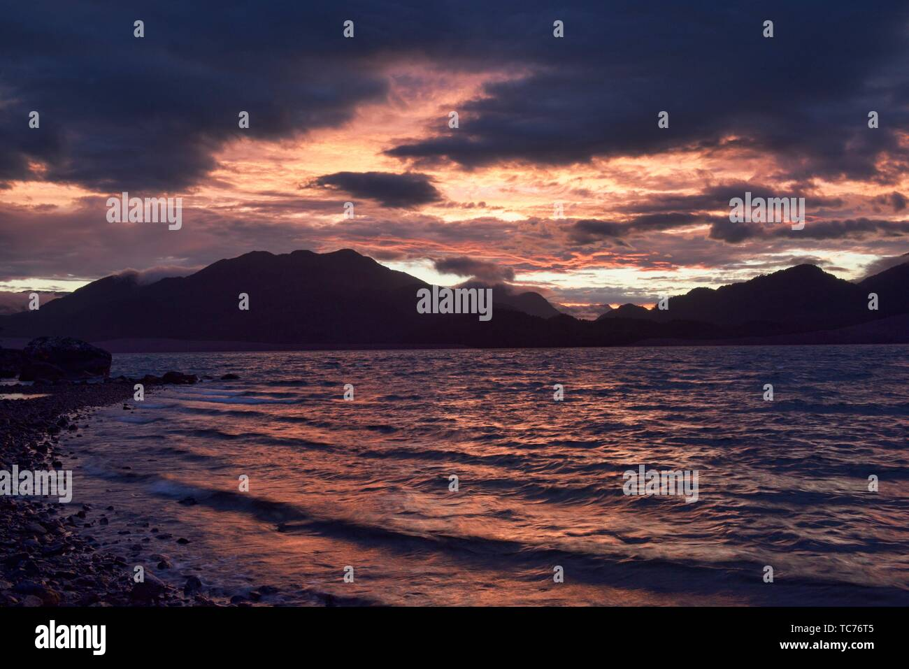 Magnificent sunset over the Puyuhuapi fjord in the Ventisquero Sound, Patagonia, Aysen, Chile. - Stock Image