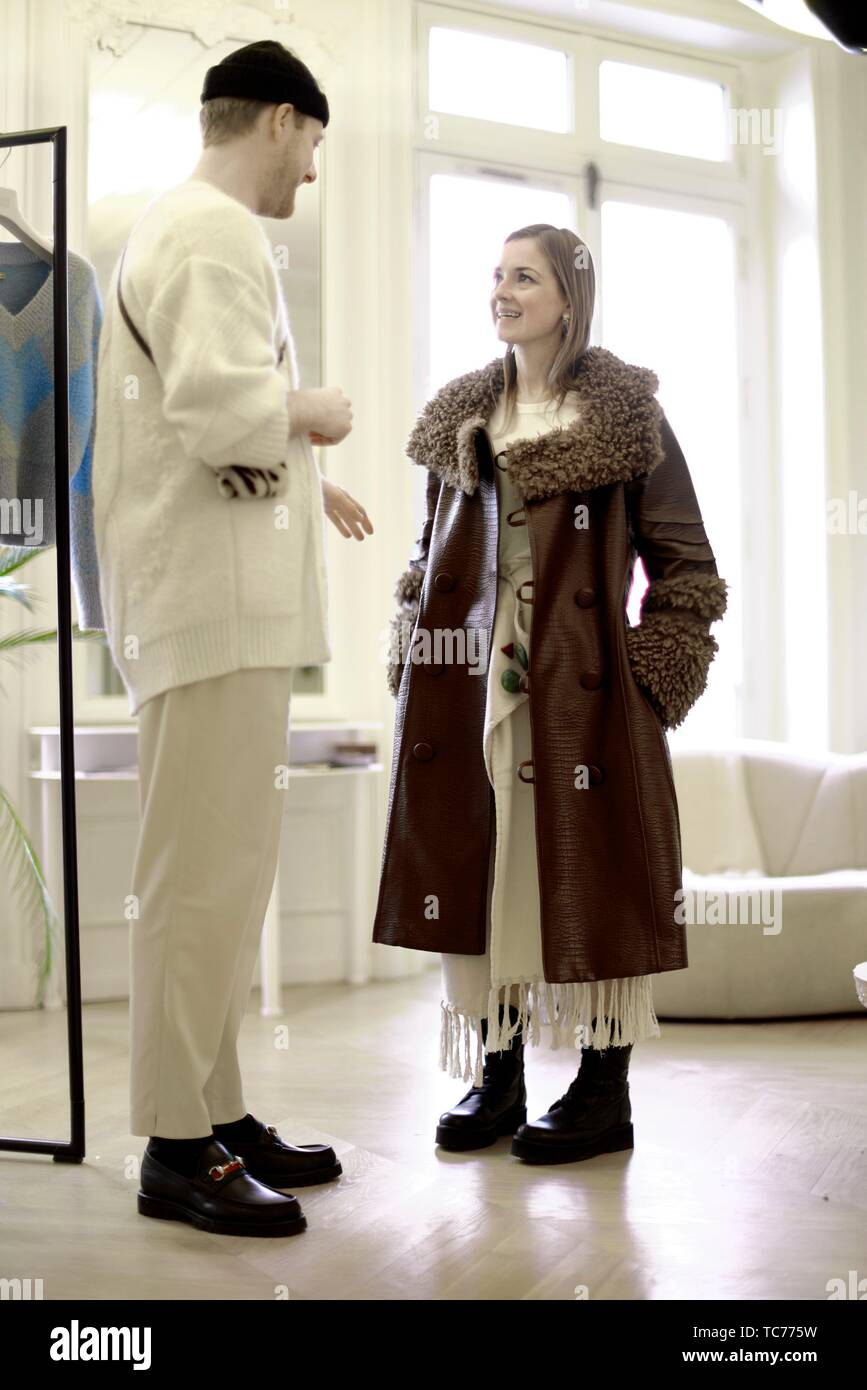 (not model released!) fashionable woman talking with designer in private showroom, in Paris, France. Stock Photo