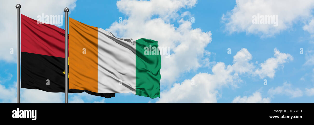 Angola and Cote D'Ivoire flag waving in the wind against white cloudy blue sky together. Diplomacy concept, international relations. - Stock Image