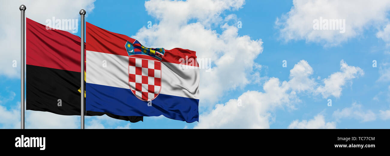 Angola and Croatia flag waving in the wind against white cloudy blue sky together. Diplomacy concept, international relations. - Stock Image