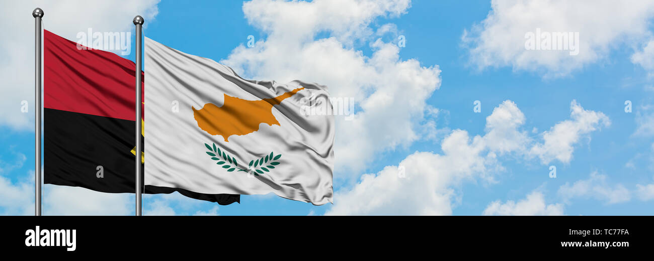 Angola and Cyprus flag waving in the wind against white cloudy blue sky together. Diplomacy concept, international relations. - Stock Image